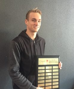 Keelan O'Neill with the JCEC Post Graduate Research Award Plaque