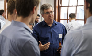 CEED Director Dr. Jeremy Leggoe talks with engineering students at the event.